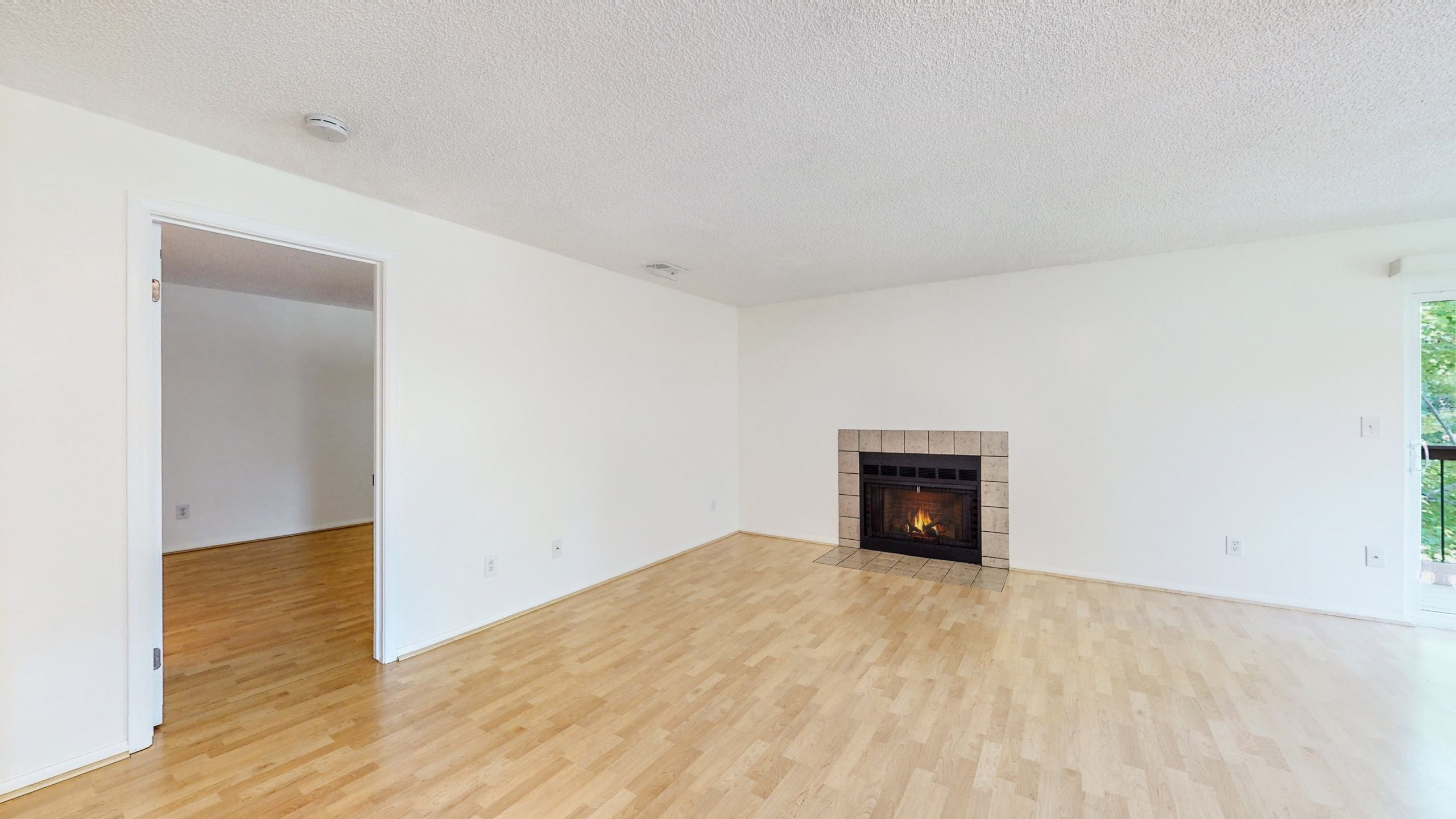 Living Room with wood floors, white walls, condo at Spinnaker Run II