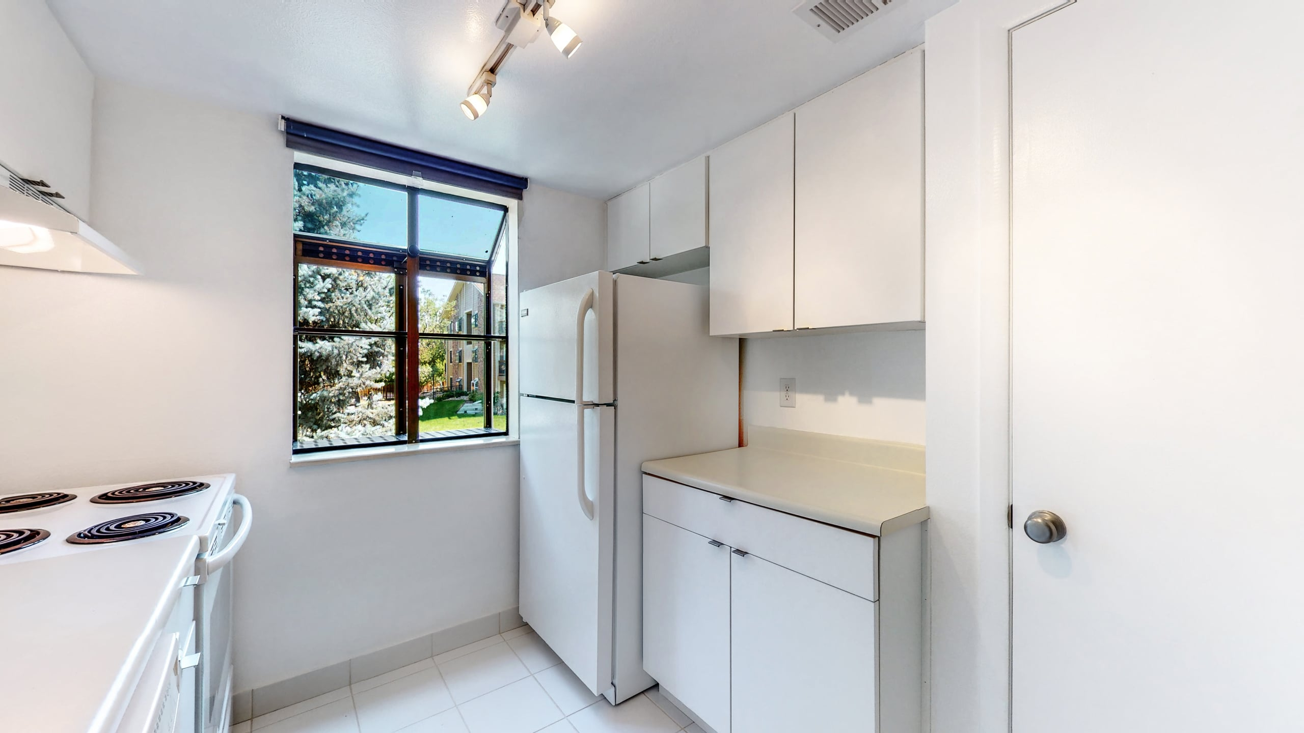 Very Clean Kitchen, White Tile Floors, White Cabinets, Condo For Sale