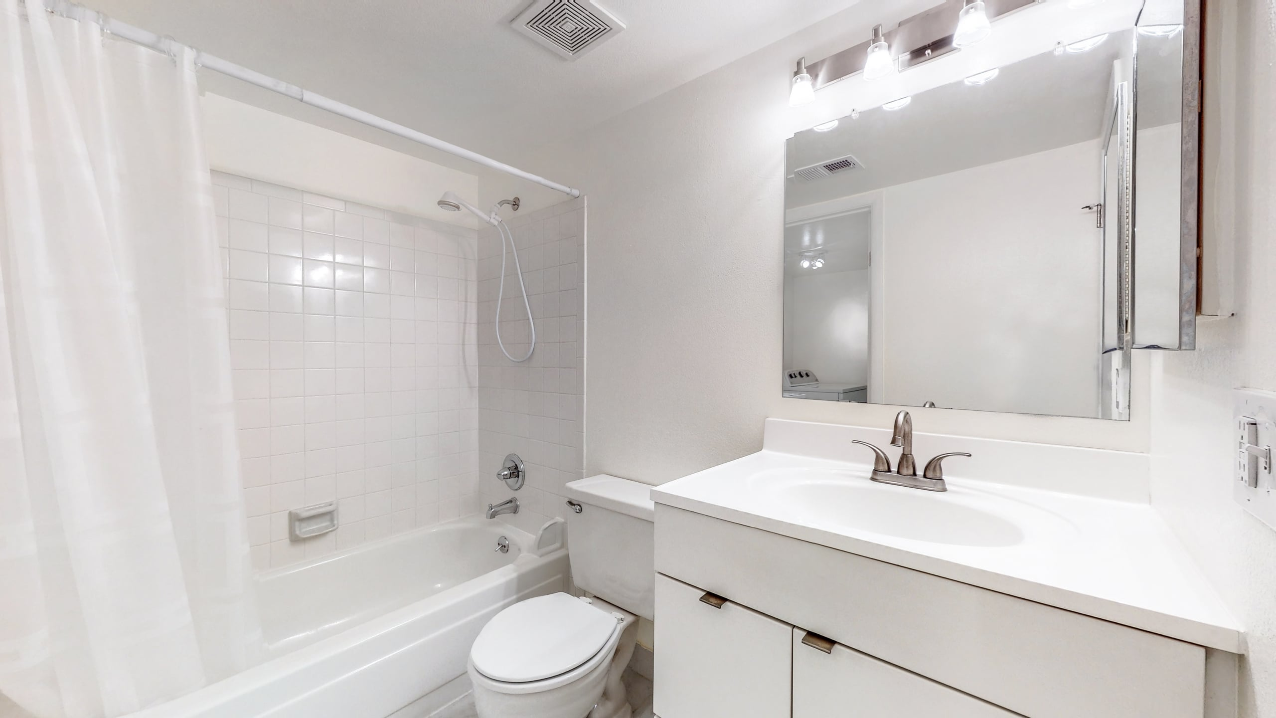 White bathroom in Aurora, CO condo at Spinnaker Run II