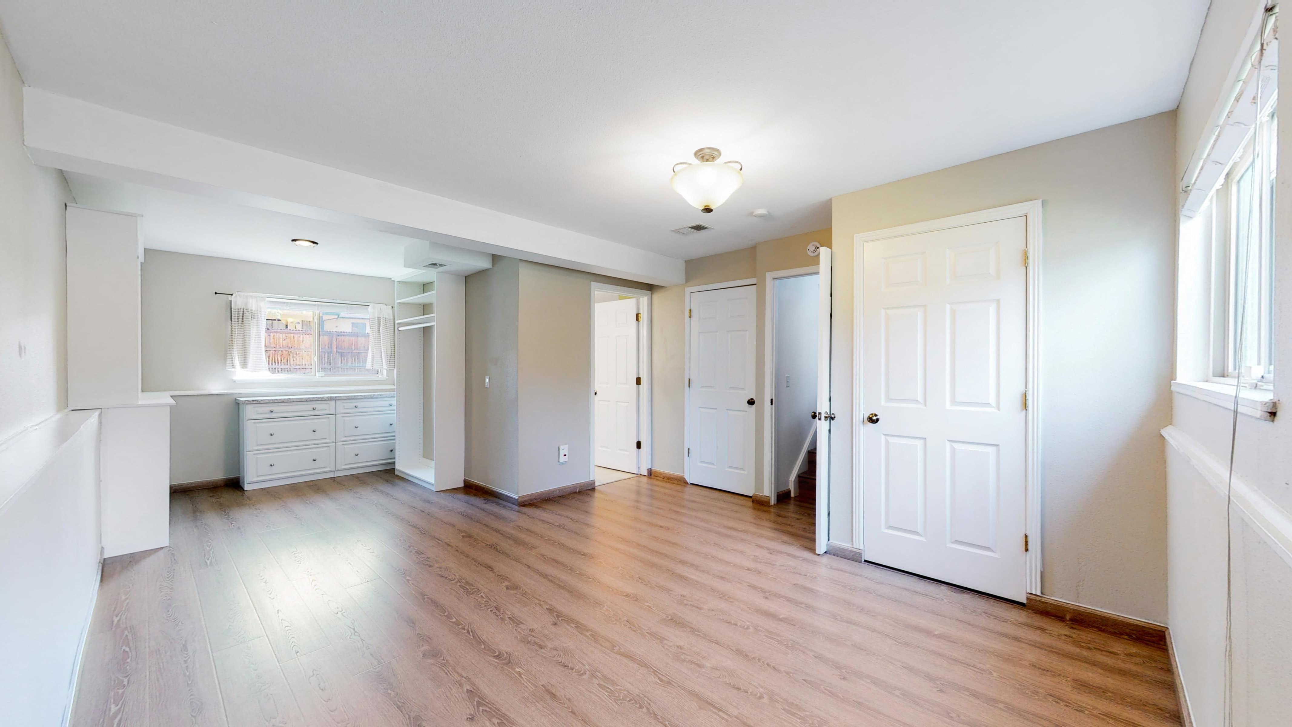Huge Master Bedroom with Pergo Floors